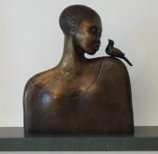 Bronze sculpture, woman and bird