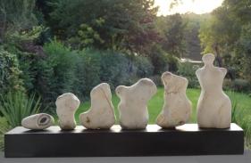 Evolution sculpture with flintstones