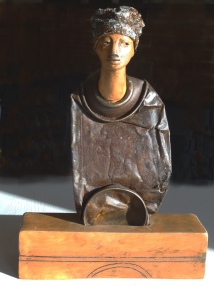 Tin and clay figure