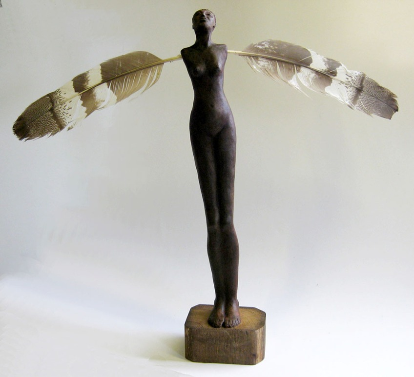 Sculpture of woman with feather arms