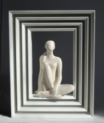 Woman sculpture in frame