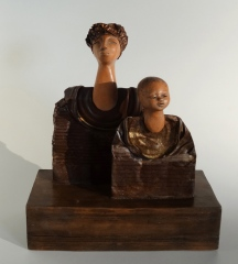 Tin sculpture of mother and daughter