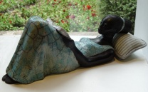 Reading woman sculpture
