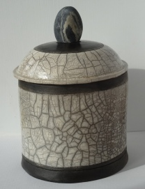 Raku jar with stone handle