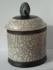 Raku jar with stone handle