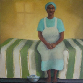 African woman sitting on bed