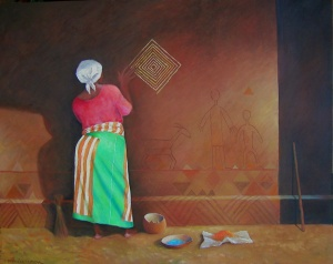 African woman decorating a wall