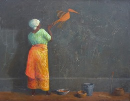 African woman painting a wall