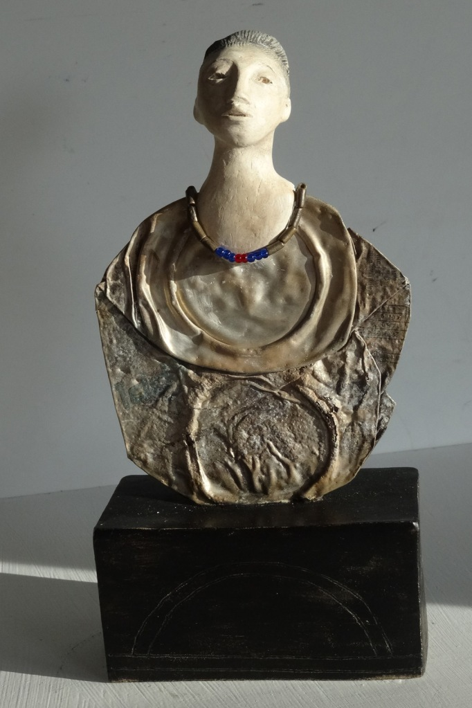 Sculpture of a woman with a flattened tin