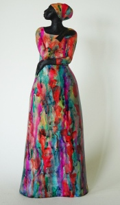 Woman sculpture with bright coloured dress, ceramic