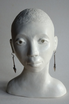 Black woman sculpture with earrings, ceramic