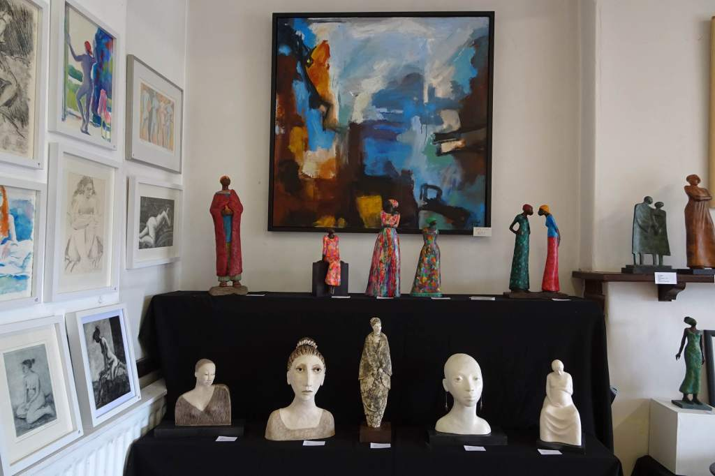 Some of my sculptures at the Art Trail with a painting by Gary O'Neil