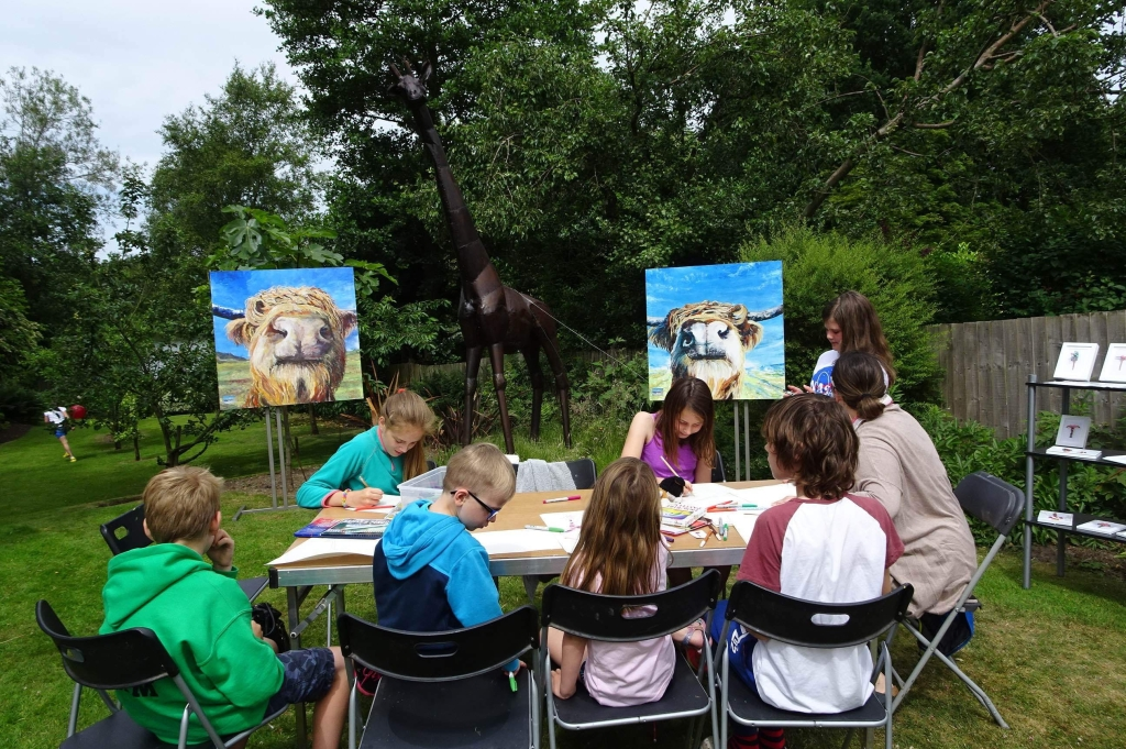 Children drawing the giraffe in our garden during the Art Trail 2018