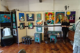 Gill with her paintings and painted furniture