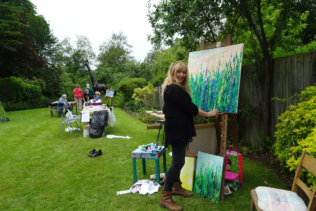 Gill painting all day Sunday in the garden